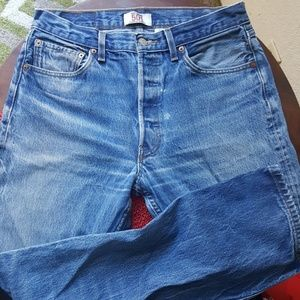 Original Levi's 501 distressed jeans with flaws.